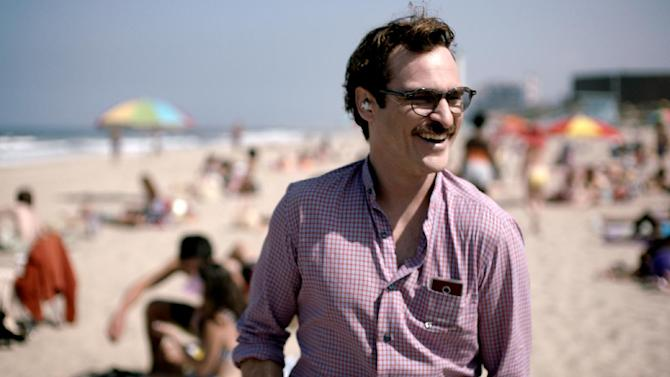 """File- This undated file image released by Warner Bros. Pictures shows Joaquin Phoenix in a scene from """"Her."""" The space odyssey """"Gravity"""" and the futuristic romance """"Her"""" have tied for best picture from the Los Angeles Film Critics Association. The LA critics announced their picks Sunday, Dec. 8, 2013, with voting culminating in a tie for the group's top honor. Spike Jonze's """"Her"""" also won best production design for K.K. Barrett's sleek, near-future designs. (AP Photo/Warner Bros. Pictures, File)"""