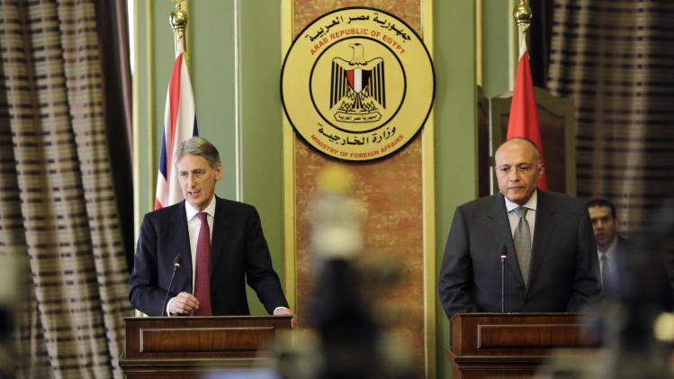 Egyptian Foreign Minister Sameh Shukri, right, and British Foreign Secretary Philip Hammond attend a press conference following their meeting at the Egyptian foreign ministry in Cairo, Egypt, Thursday, July 24, 2014. Hammond on Thursday urged Hamas to agree on an immediate humanitarian cease-fire and said Israel and Palestinian Authority could then come together to hold talks. (AP Photo/Amr Nabil)