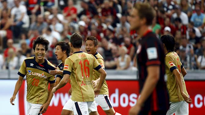 Maeda of FC Tokyo celebrates with his teammates after scoring against German first soccer division Bundesliga club Eintracht Frankfurt during their pre-season friendly soccer match in Frankfurt