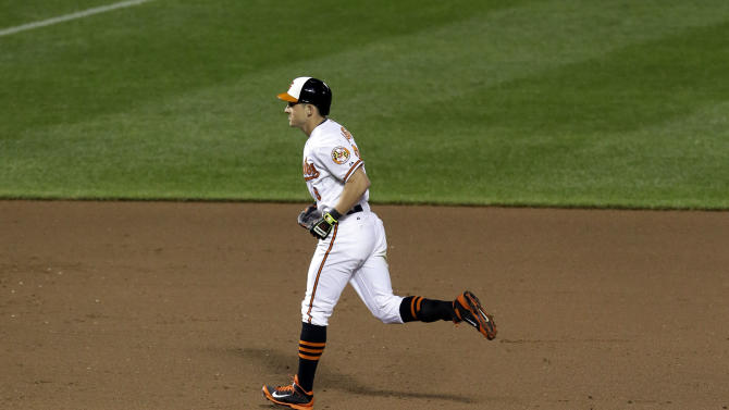 Baltimore Orioles' David Lough, top, rounds the bases past Toronto Blue Jays relief pitcher Casey Janssen after hitting a solo home run in the eighth inning of a baseball game, Wednesday, Sept. 17, 2014, in Baltimore. Baltimore won 6-1. (AP Photo/Patrick Semansky)