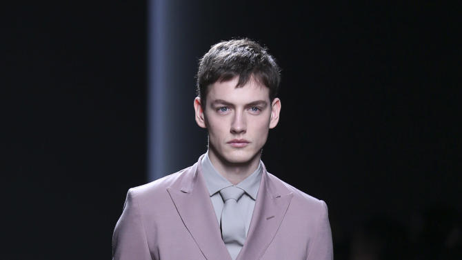 A model wears a creation for Bottega Veneta men's Fall-Winter 2013-14 collection, part of the Milan Fashion Week, unveiled in Milan, Italy, Sunday, Jan. 13, 2013. (AP Photo/Luca Bruno)