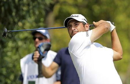 Levy of France tees off on the fourth hole during the third day of the China Open at Tomson Golf Club in Pudong, Shanghai