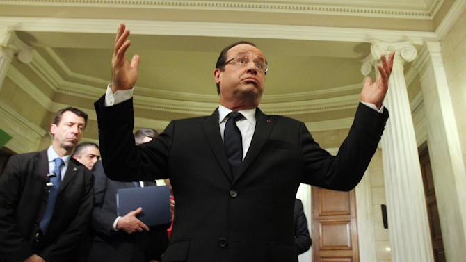 "French President Francois Hollande gestures as he speaks to the media following a news conference with Greece's Prime Minister Antonis Samaras, not seen, at Maximos mansion in Athens, Tuesday, Feb. 19, 2013. Hollande has said his country will miss its economic growth target this year. Speaking during a brief visit to Athens on Tuesday, Hollande said that ""everyone knows that for 2013, we will not reach our target, which was 0.8 percent."" (AP Photo/Thanassis Stavrakis, Pool)"