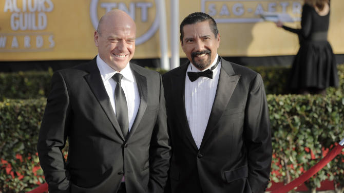 """FILE - This Jan. 27, 2013 file photo shows actors Dean Norris, left, and Steven Michael Quezada at the 19th Annual Screen Actors Guild Awards  in Los Angeles. Quezada, who plays federal drug agent Steven Gomez on the Albuquerque-based show """"Breaking Bad,"""" is running unopposed Tuesday, Feb. 5, 2013, for a seat on Albuquerque's school board.  Norris stars with Quezada on the popular AMC show. (Photo by Chris Pizzello/Invision/AP, file)"""