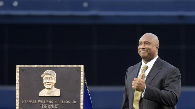Former New York Yankees' Bernie Williams gives a thumbs-up after unveiling a replica of his plaque displayed in Monument Park before a baseball game against the Texas Rangers, Sunday, May 24, 2015, at Yankee Stadium in New York. (AP Photo/Bill Kostroun)