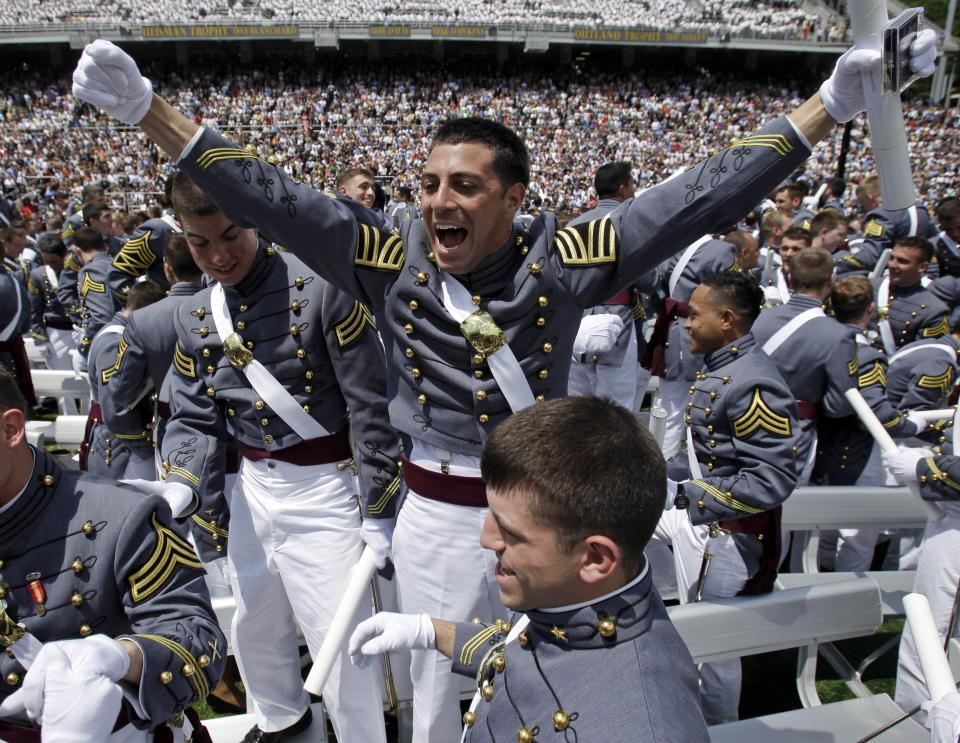 Graduating cadet Dario Marcelli of East Hanover, N.J., reacts after a graduation and commissioning ceremony at the U.S. Military Academy in West Point, N.Y., on Saturday, May 21, 2011.   (AP Photo/Mike Groll)