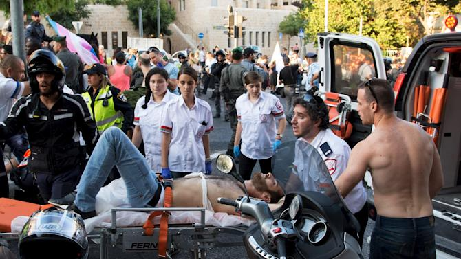 A participant of an annual gay pride parade is treated after an Orthodox Jewish assailant stabbed and injured six participants in Jerusalem on Thursday, police and witnesses said