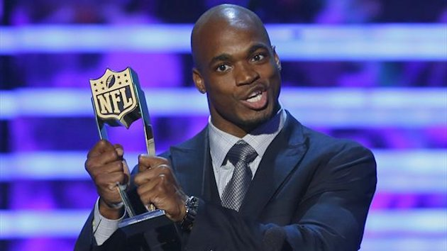 Minnesota Vikings running back Adrian Peterson accepts the award for the NFL Fantasy Player of the Year during the NFL Honors award show