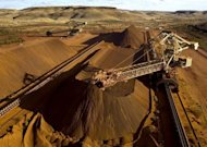 File photo of a reclaimer working at the Rio Tinto Yandicoogina stockyard in Western Australia's Pilbara region. Global mining giant Rio Tinto said Tuesday its business was performing strongly despite global volatility, affirming annual targets and reporting a quarterly record in Australian iron ore output