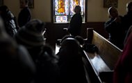 Without lights or heat, parishioners take part in a Sunday service at St. Camillus Roman Catholic Church in the Rockaway Park neighborhood of the borough of Queens, New York, Sunday, Nov.11, 2012, almost two weeks in the wake of Superstorm Sandy. Cleanup was continuing on the church's damaged lower level. (AP Photo/Craig Ruttle)