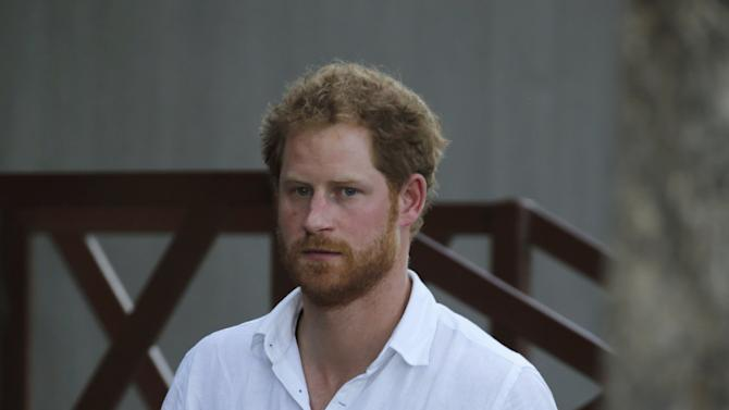 """Britain's Prince Harry arrives to meet a Belgian Malinois named """"Killer"""" and his handler during his visit to the Kruger National Park in Mpumalanga province"""