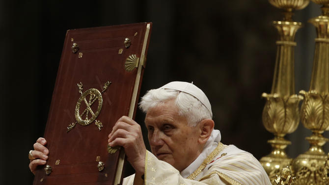 Pope Benedict XVI holds up the book of the gospel as he celebrates the Christmas Eve Mass in St. Peter's Basilica at the Vatican, Monday, Dec. 24, 2012. Heralded by the blare of trumpets reflecting Christmas joy, Pope Benedict XVI is presiding over Christmas Eve Mass in St. Peter's Basilica, packed with tourists, Romans and other faithful. The ceremony began at 10 p.m. (2100 GMT) Monday night instead of the traditional midnight start time, which was changed at the Vatican years ago to let the pontiff rest before a Christmas Day speech to be delivered the next day from the basilica's central balcony. (AP Photo/Gregorio Borgia)