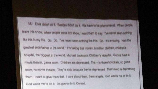 Part of the transcript of a recording of Michael Jackson on Dr. Conrad Murray's phone is shown on this evidence projection screen during Murray's trial in the death of pop star Jackson in Los Angeles, Wednesday, Oct. 5, 2011. (AP Photo/Mario Anzuoni, Pool)