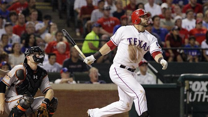 Texas Rangers' Mitch Moreland, right, and Baltimore Orioles catcher Matt Wieters watch Moreland's grand slam during the fourth inning of a baseball game, Wednesday, Aug. 22, 2012, in Arlington, Texas. (AP Photo/LM Otero)