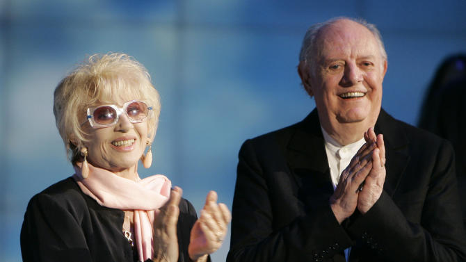 """FILE - In this May 9, 2009 file photo Italian Nobel prize winner Dario Fo, right, and his wife Franca Rame applaud during the Italian State RAI TV program """"Che Tempo che Fa"""", in Milan. Franca Rame has died in Milan, Wednesday, May 29, 2013. She was 84. (AP Photo/Antonio Calanni, File)"""