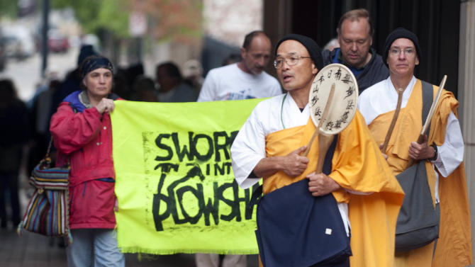 Buddhists Gtydshu Utsumi and Denise Laffan march in support of three Transform Now Plowshares activists who are on trial Tuesday, May 7, 2013, in Knoxville, Tenn. Three activists face federal trespassing and destruction of property charges for the July 28, 2012, intrusion at the Y-12 nuclear weapons plant. (AP Photo/Knoxville News Sentinel, J. Miles Cary)