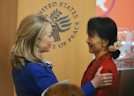 US Secretary of State of Hillary Clinton speaks to Myanmar member of parliament and democracy icon Aung San Suu Kyi after introducing her at the United States Institute of Peace September 18