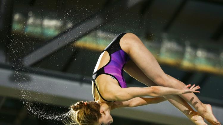 Timoshinina of Russia jumps during the women's 10 m platform fnal at the European Swimming Championships in Berlin