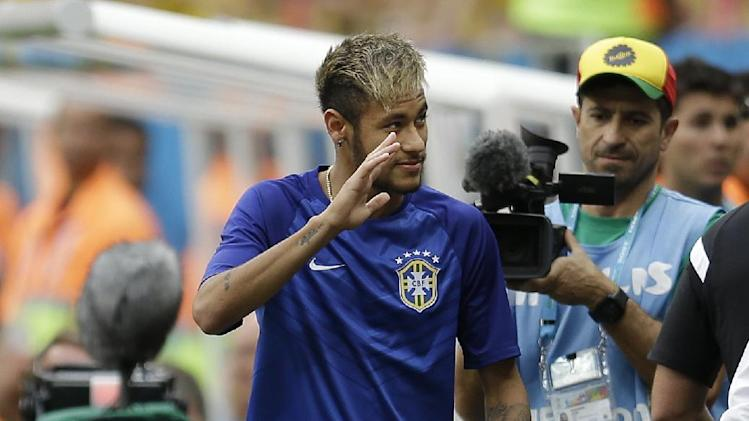 Brazil's Neymar walks on the sidelines before the World Cup third-place soccer match between Brazil and the Netherlands at the Estadio Nacional in Brasilia, Brazil, Saturday, July 12, 2014. Neymar suffered a back injury during the quarterfinal match against Colombia and is unable to play since then. (AP Photo/Natacha Pisarenko)