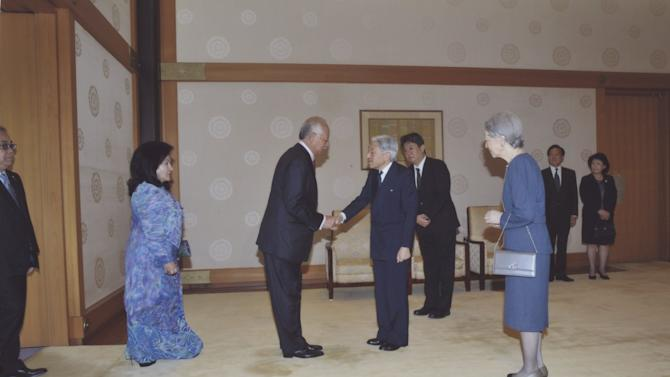Malaysian PM Razak and his wife Mansor are greeted by Japanese Emperor Akihito and Empress Michiko upon their arrival for an audience at the Imperial Palace in Tokyo