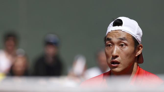 Go Soeda of Japan reacts during the men's singles match against Philipp Kohlschreiber of Germany at the French Open tennis tournament at the Roland Garros stadium in Paris