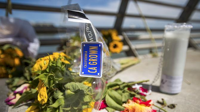 Flowers and a candle form a makeshift memorial for shooting victim Kathryn Steinle on Pier 14 in San Francisco