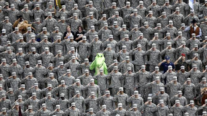 A cadet dressed in an alligator mascot outfit joins fellow cadets in a salute during the national anthem before an NCAA college football game between Army and Stanford on Saturday, Sept. 14, 2013, in West Point, N.Y