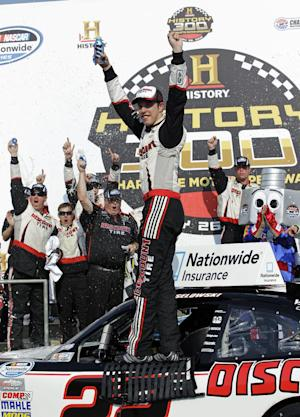 Brad Keselowski poses in victory lane after winning the NASCAR Nationwide Series History 300 auto race in Concord, N.C., Saturday, May 26, 2012. (AP Photo/Chuck Burton)