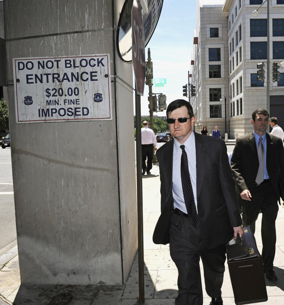 Government prosecutor Steve Durham walks away from federal court in Washington, Thursday, July 14, 2011, after a mistrial was declared in the government's case against former Major League Baseball pitcher Roger Clemens. (AP Photo/Cliff Owen)