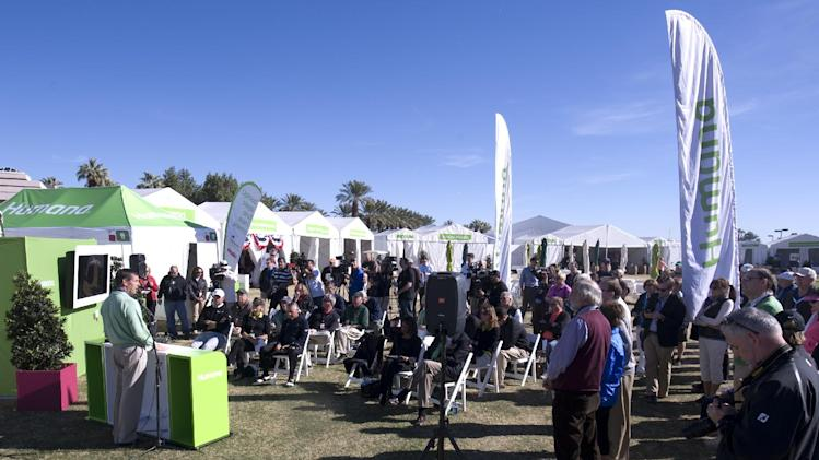 "IMAGE DISTRIBUTED FOR HUMANA- Humana President and CEO Bruce Broussard addresses a throng of media at the ""What's New at the Humana Challenge"" press event on January 16, 2013, at PGA West in La Quinta, Calif. At the event, Humana introduced its exciting new initiatives for the 2013 edition of the Humana Challenge PGA TOUR golf tournament, including the Humana Walkit Challenge and the Humana Walkit Pro programs. The Humana Walkit Challenge encourages tournament attendees count their steps via Humana-distributed pedometers and will challenge fans at other PGA TOUR stops throughout the year to meet or surpass the number of steps taken during the Humana Challenge. The Humana Walkit Pro program will simulate the number of steps taken and calories burned by every player on the course in real time using ShotLink technology throughout the Humana Challenge, and display that data on leaderboards on the course and via the Golf Channel broadcast. The Humana Challenge is being held January 14-20 in La Quinta. (Rodrigo Pena / AP Images for Humana)"