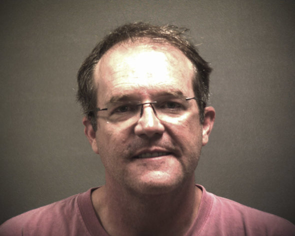 This photo provided by the Lubbock Police Department, shows Dr. Thomas Michael Dixon, a plastic surgeon who was arrested with David Neal Shepard for murder in Lubbock, Texas. Documents in an arrest warrant suggest Dixon arranged to have Dr. Joseph Sonnier III killed because Sonnier was dating Dixons ex-girlfriend. Sonnier III was found dead Thursday, July 12, 2012. (AP Photo/ Lubbock Police Department)