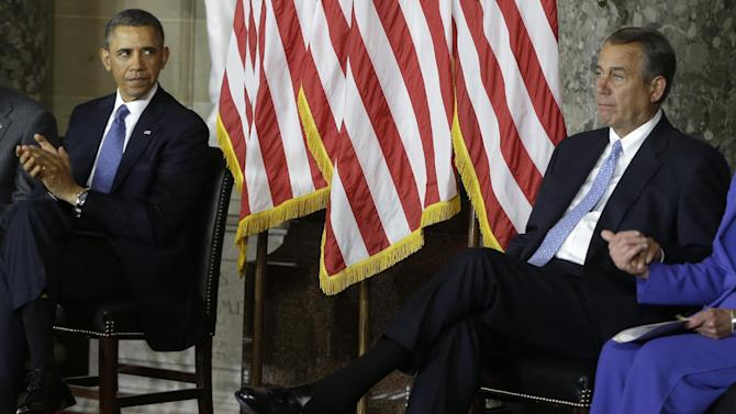 President Barack Obama and House Speaker John Boehner of Ohio, right, are seated during speeches during the unveiling of a statue of Rosa Parks, Wednesday, Feb. 27, 2013, on Capitol Hill in Washington. (AP Photo/Charles Dharapak)