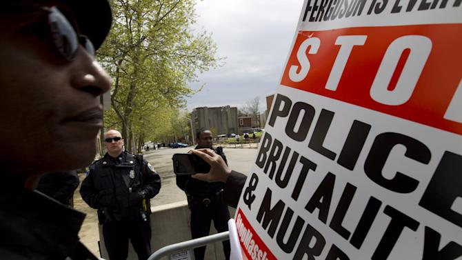 Demonstrators protest in the streets as they march for Freddie Gray to Baltimore's City Hall, Saturday, April 25, 2015. Gray died from spinal injuries about a week after he was arrested and transported in a police van. (AP Photo/Jose Luis Magana)