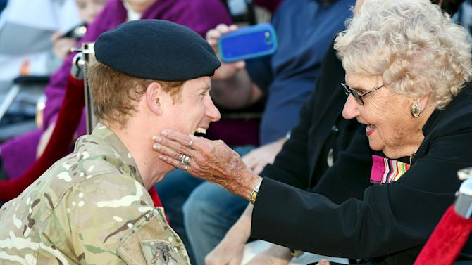 Britain's Prince Harry speaks with Sydney resident Daphne Dunne as he meets wellwishers during a visit to Sydney's Opera House in Australia