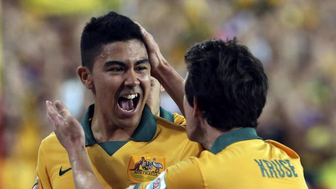 Australia's Massimo Luongo celebrates with teammate Robbie Kruse after scoring a goal against South Korea during their Asian Cup final soccer match at the Stadium Australia in Sydney