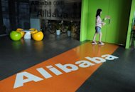 A Chinese Alibaba employee walks through a communal space at the company headquarters in Hangzhou in June 2012. Top Chinese e-commerce operator Alibaba said Friday it would not tolerate corruption, after a senior manager was detained on suspicion of taking bribes in the latest graft scandal to hit the company