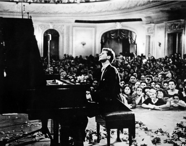 In this photo provided by the Van Cliburn Foundation, Texas pianist Van Cliburn performs to a packed audience in the Great Hall of the Moscow Conservatory in Moscow, Russia, in April 1958 during the f
