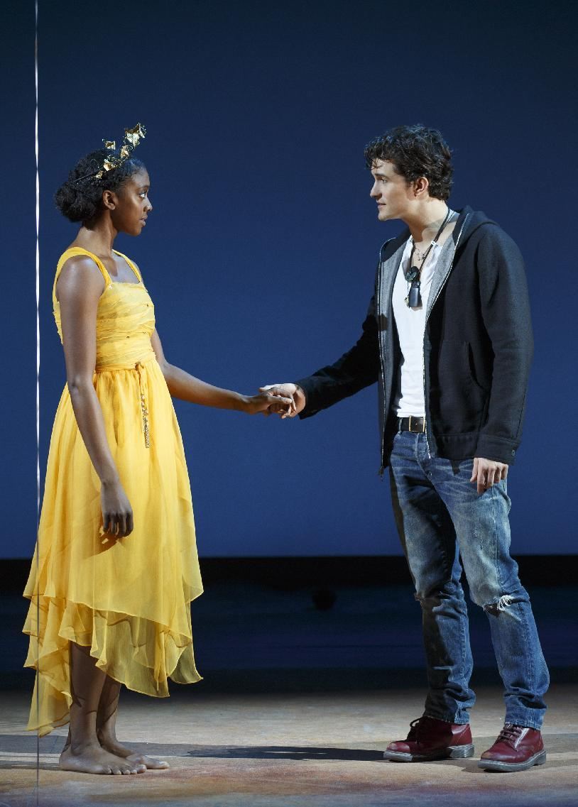"This theater image released by The Hartman Group shows Condola Rashad, left, and Orlando Bloom during a performance of ""Romeo and Juliet,"" in New York. (AP Photo/The Hartman Group, Carol Rosegg)"