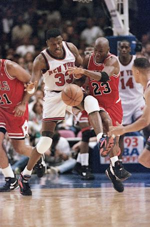 FILE - In this June 3, 1993, file photo, Chicago Bulls, Michael Jordan, right, and New York Knicks' Patrick Ewing chase a loose ball during the second half of game 5 of the Eastern Conference finals in New York. Ewing sees the parallels between then and now. Ewing says when he played, it was mostly one superstar per team. He believes the league is heading back that way now and many say a more-balanced playing field across the NBA could be better for the league. (AP Photo/Ron Frehm, File)