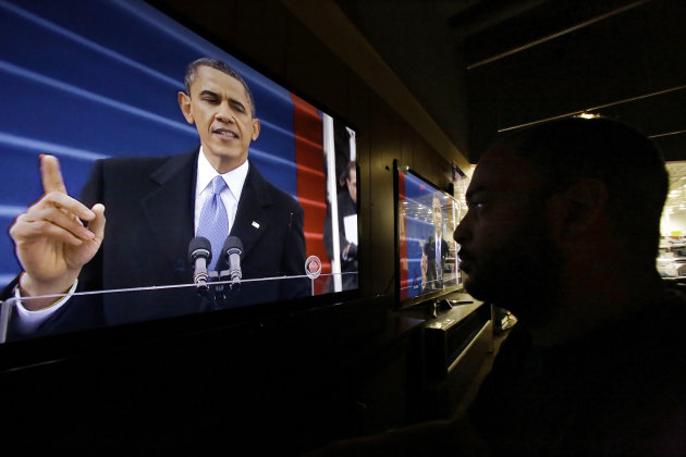 &lt;p&gt;               Richard Smith watches President Barack Obama deliver his inaugural address during the ceremonial swearing-in, on a television at a Best Buy department store in Springfield, Ill., Monday, Jan. 21, 2013. (AP Photo/Seth Perlman)