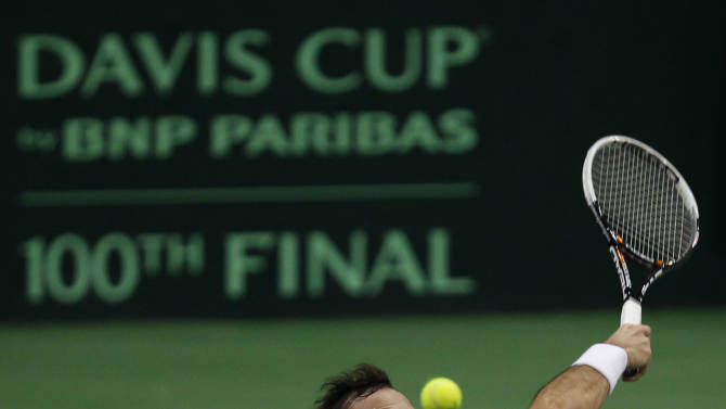 Czech Republic's Radek Stepanek returns the ball to Spain's David Ferrer during their tennis Davis Cup finals singles match in Prague, Czech Republic, Friday, Nov. 16, 2010. (AP Photo/ Marko Drobnjakovic)