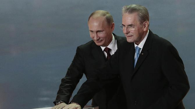 Russian President Vladimir Putin, left, and IOC President Jaques Rogge press a symbolic button to mark a 1 year to the start of 2014 Winter Olympics, in Sochi, Russia, on Thursday, Feb. 7, 2013. (AP Photo/Ivan Sekretarev)