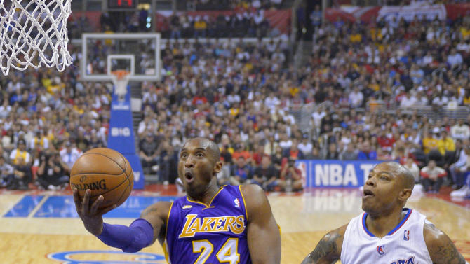 Los Angeles Lakers guard Kobe Bryant (24) shoots as Los Angeles Clippers forward Caron Butler defends during the first half of their NBA basketball game, Sunday, April 7, 2013, in Los Angeles. (AP Photo/Mark J. Terrill)