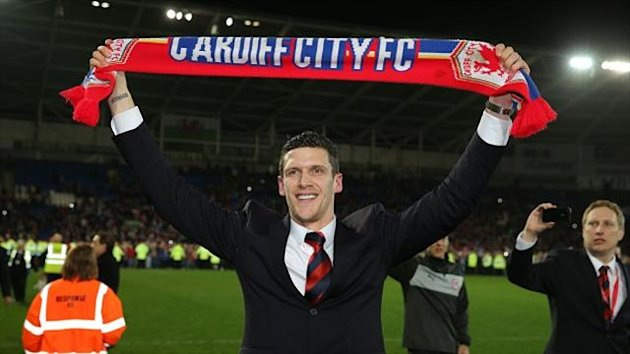 Mark Hudson celebrates promotion with Cardiff (PA)