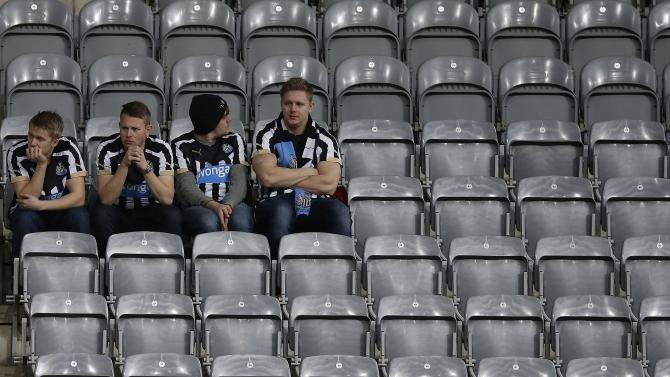Newcastle United fans react after their 1-0 defeat to Sunderland during their English Premier League soccer match in Newcastle