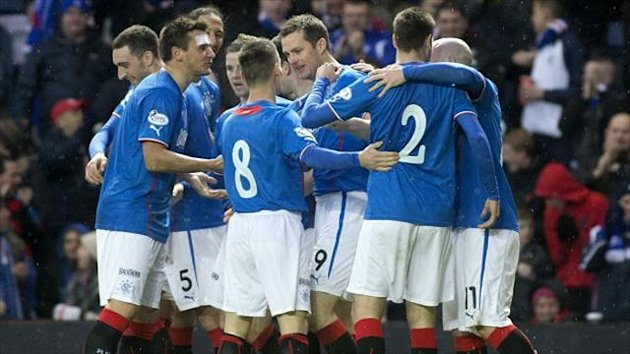 Jon Daly, centre, celebrates his 16th goal of the season