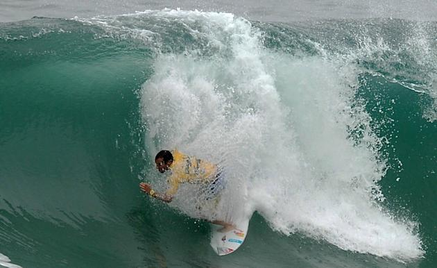 Portuguese surfer Tiago Pires competes in the Association of Surfing Professionals' men's 2012 ASP World Championship Tour at Barra da Tijuca beach in Rio de Janeiro, Brazil, on May 14, 2012.  AFP PHO