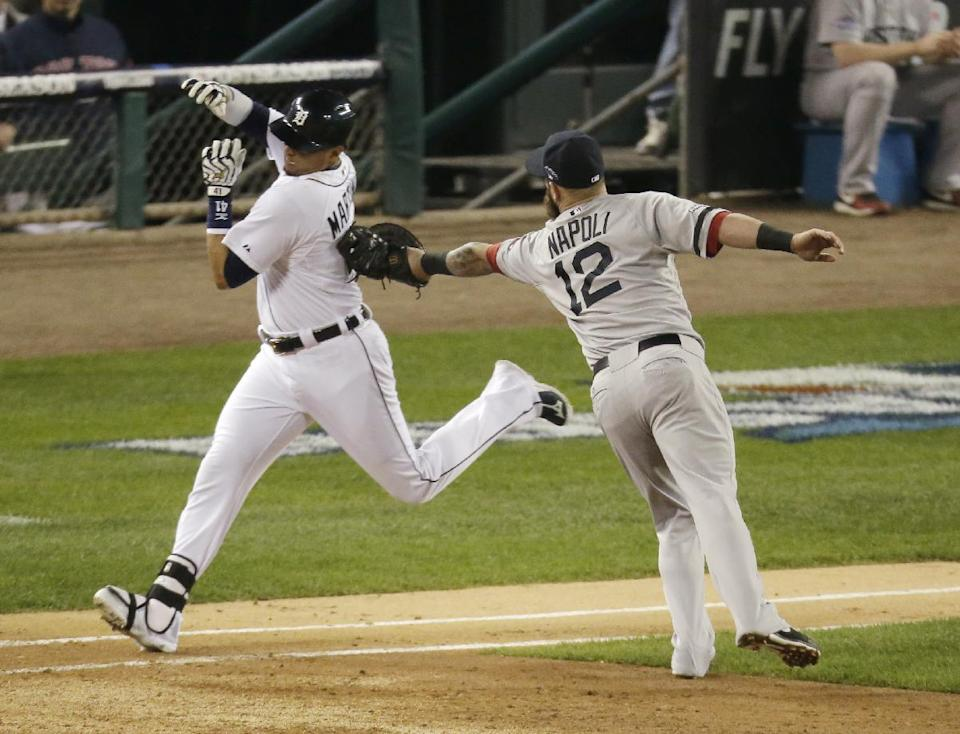Boston Red Sox first baseman Mike Napoli tags out Detroit Tigers' Victor Martinez in the third inning during Game 4 of the American League baseball championship series Wednesday, Oct. 16, 2013, in Detroit. (AP Photo/Charlie Riedel)