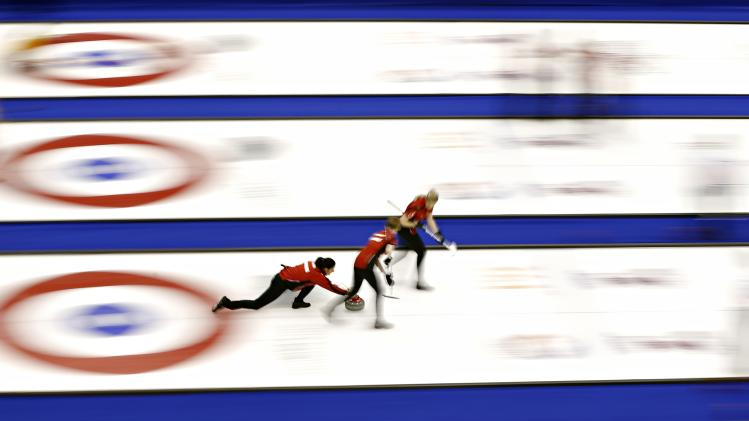 Switzerland's skip Feltscher delivers a stone during their draw against Latvia at the World Women's Curling Championships in St. John