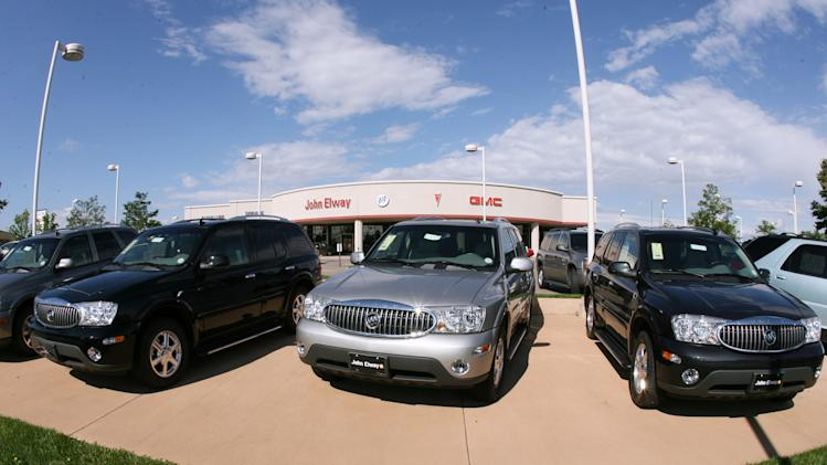 RETRANSMISSION TO CORRECT NUMBER OF VEHICLES RECALLED TO 258,000 - FILE - In this Aug. 27, 2006 file photo, a trio of unsold 2006 Buick Rainier sports utility vehicles sits in front of a Buick dealership in the southeast Denver suburb of Lone Tree, Colo. General Motors and Isuzu are recalling more than 258,000 SUVs because the window and door lock switches can cause fires. The recall covers the Chevrolet TrailBlazer, GMC Envoy, Buick Rainier, Isuzu Ascender and Saab 97-X SUVs from the 2006 and 2007 model years. The SUVs were sold or registered in 20 states and Washington, D.C., where salt and other chemicals are used to clear roads in the winter, Saturday, Aug. 18, 2012. (AP Photo/David Zalubowski, File)
